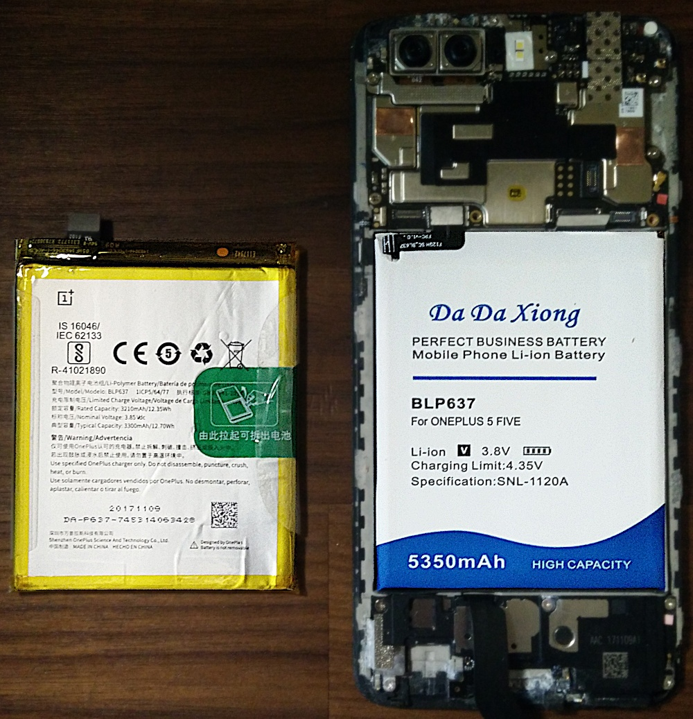Photo of the OEM battery and the aftermarket battery side-by-side